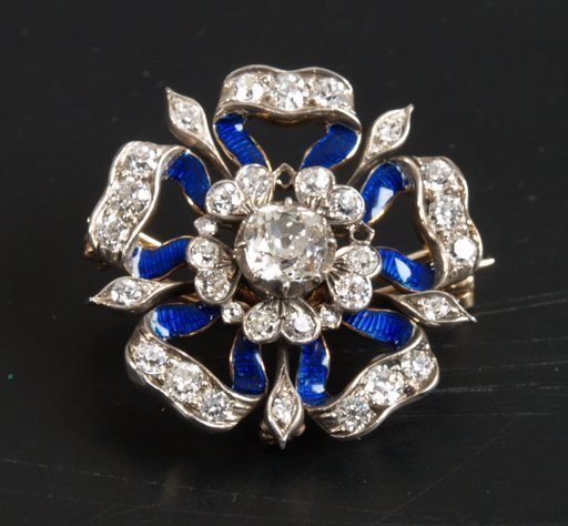 15: Old cut diamond and blue enamel brooch in the style
