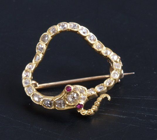 Circular snake brooch (ourobouros) set with old cut