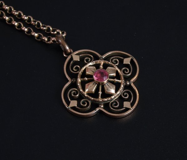 24: Edwardian open work pendant with central red stone