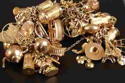 720: 9ct gold charm bracelet with approximately fifty c