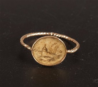 785: Gold mounted oval  plaque ring with sepia inset se
