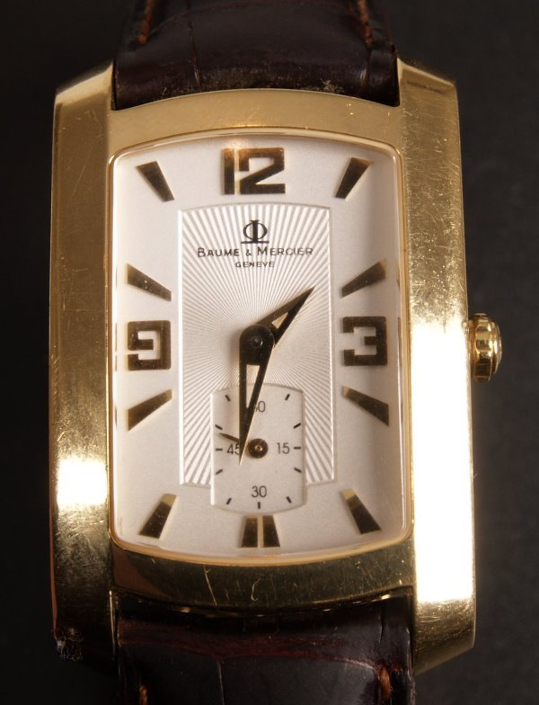 1002: BAUME & MERCIER - a gentleman's 18ct gold shaped