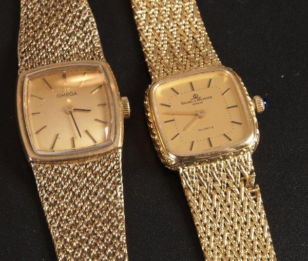 1004: BAUME & MERCIER - a ladies 18ct gold square face