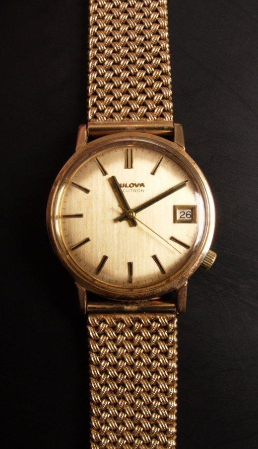 1009: BULOVA - a gentleman's 9ct gold Accutron watch wi