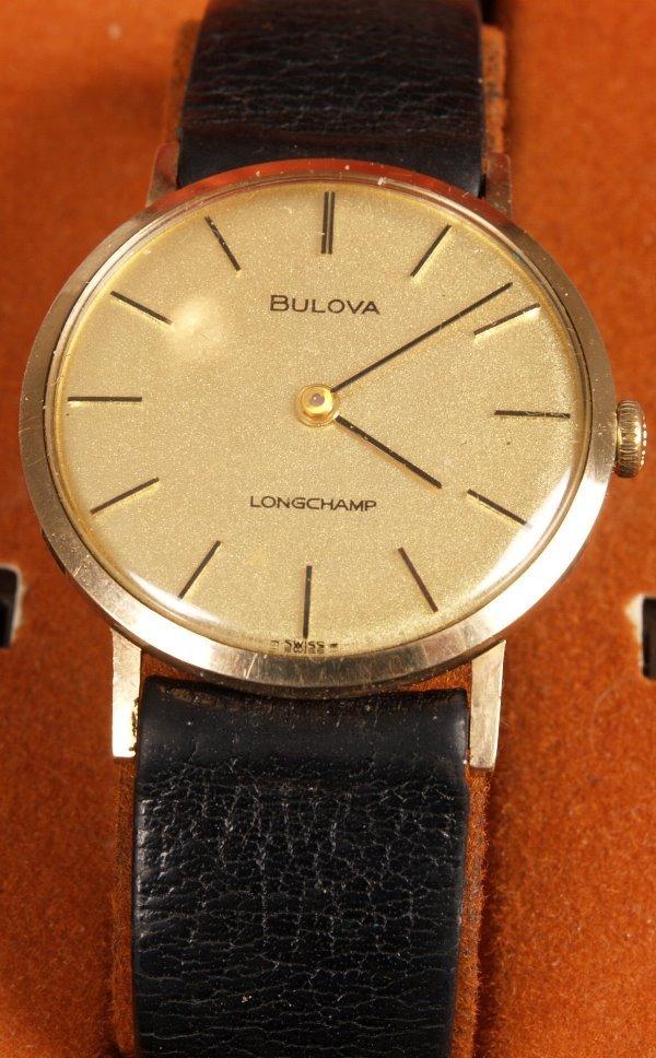 1012: BULOVA - a gentleman's 9ct gold Longchamp manual
