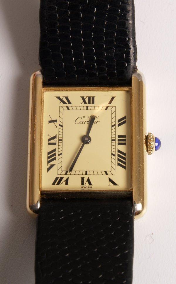 1019: CARTIER - a gentleman's silver gilt Tank watch fi