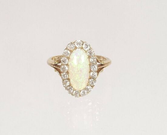 1006: Edwardian 18ct gold oval opal and old c