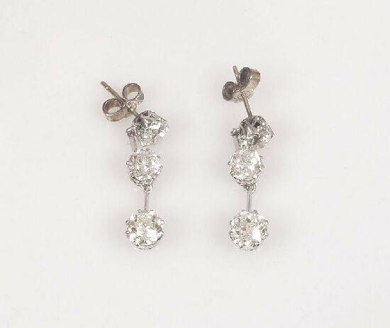 1007: A pair of diamond set dropper earrings