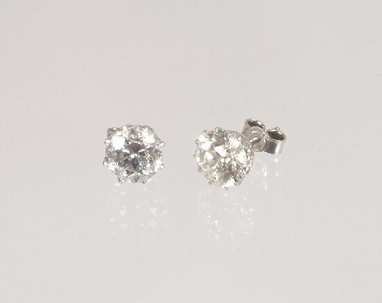 1013: A pair of full old cut brilliant diamon