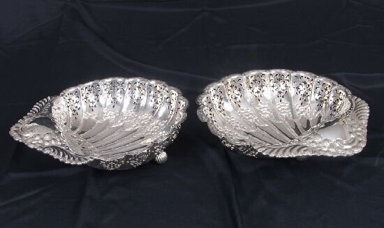 2024: A pair of Edwardian scallop shaped dish
