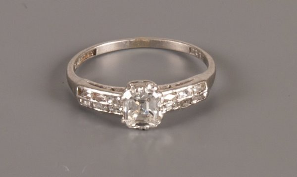 4: Platinum set step cut single stone diamond ring of a