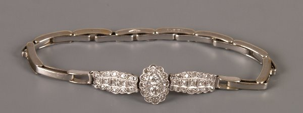 5: Edwardian diamond half bracelet with a central oval