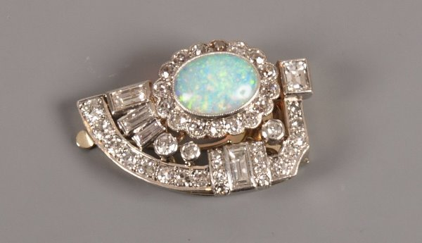 7: 1920's opal and diamond  D-shape clip brooch with an