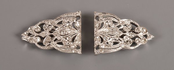 8: A pair of diamond set clip brooches of floral design
