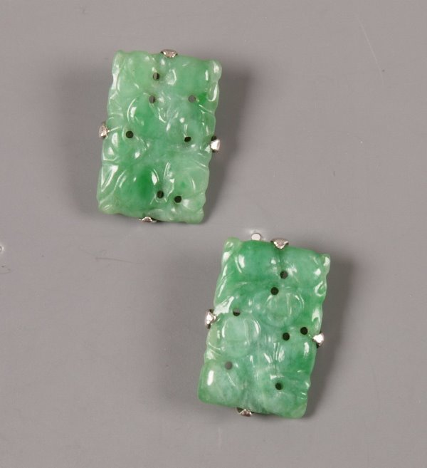 13: A pair of rectangular apple green carved jade earri