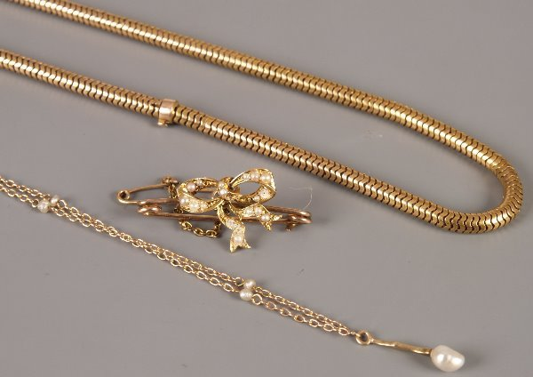 14: Two unmarked gold chains - a snake line necklace (1