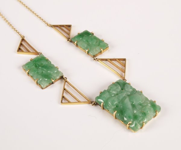 20: A green jade set necklace with three rectangular fo