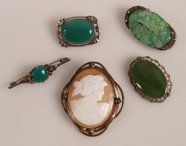 21: A green jade oval foliate carved marcasite  brooch,