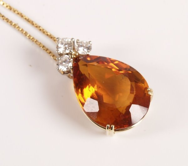 30: 18ct gold mounted large pear shape golden citrine p
