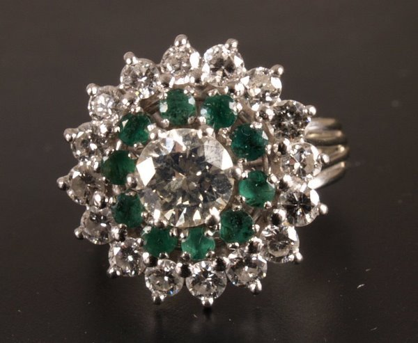 1: Diamond and emerald cluster ring mounted in 18ct whi