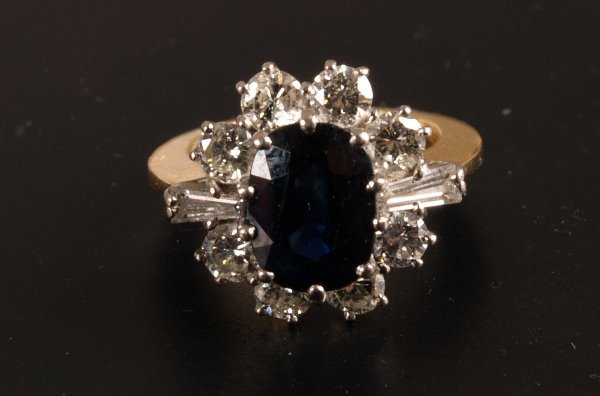 4: Oval sapphire and diamond cluster ring - the central