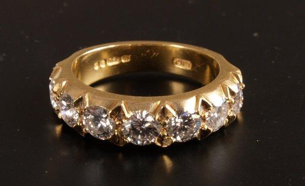7: 18ct gold seven stone diamond half eternity ring of