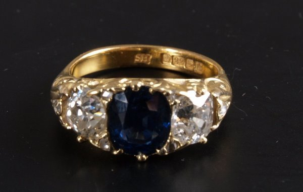 8: Oval sapphire and old european cut diamond three sto