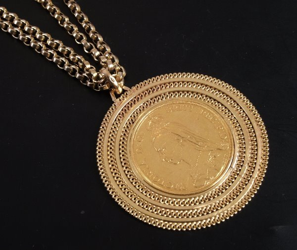 14: 14ct gold mounted two pound coin pendant dated 1887