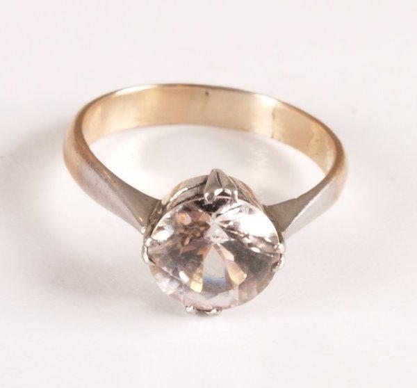 18: A single stone white sapphire claw set dress ring o