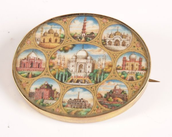 23: 9ct gold mounted brooch with central panel depictin