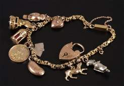 587: Fancy link bracelet, with ten attached charms (to