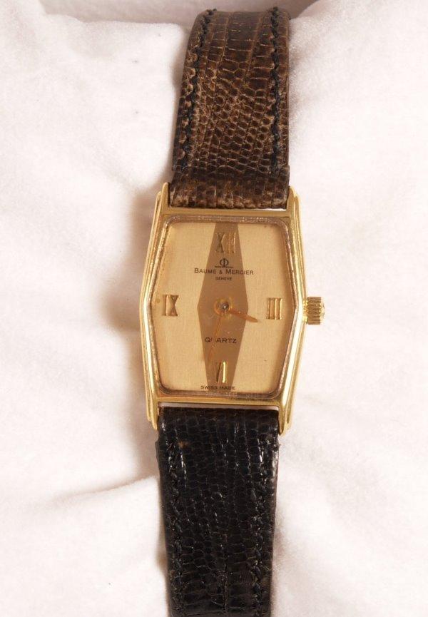 2002: BAUME & MERCIER - a ladies 18ct gold rectangular