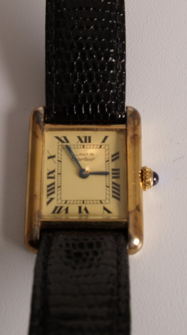 2012: CARTIER - ladie's silver gilt Tank watch on leath