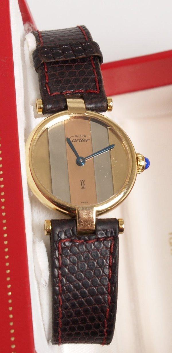 2017: CARTIER - a ladies Must de Cartier silver gilt ro