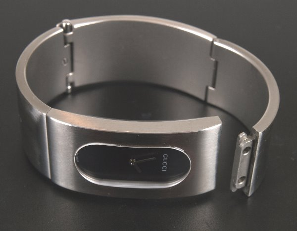 2023: GUCCI - ladie's brushed steel bangle watch with o