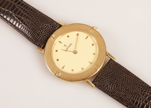 2145: TITAN - 18k Tanishq gentleman's watch with circul