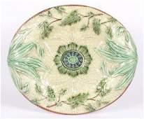 59: A Victorian majolica oval bread plate, re