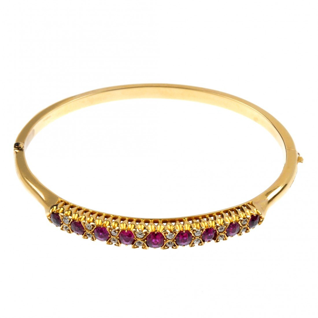 8: A ruby and diamond hinged bangle. The graduated circ