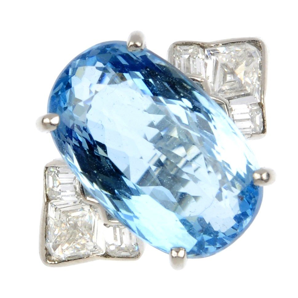 10: A platinum aquamarine and diamond ring. The oval-sh