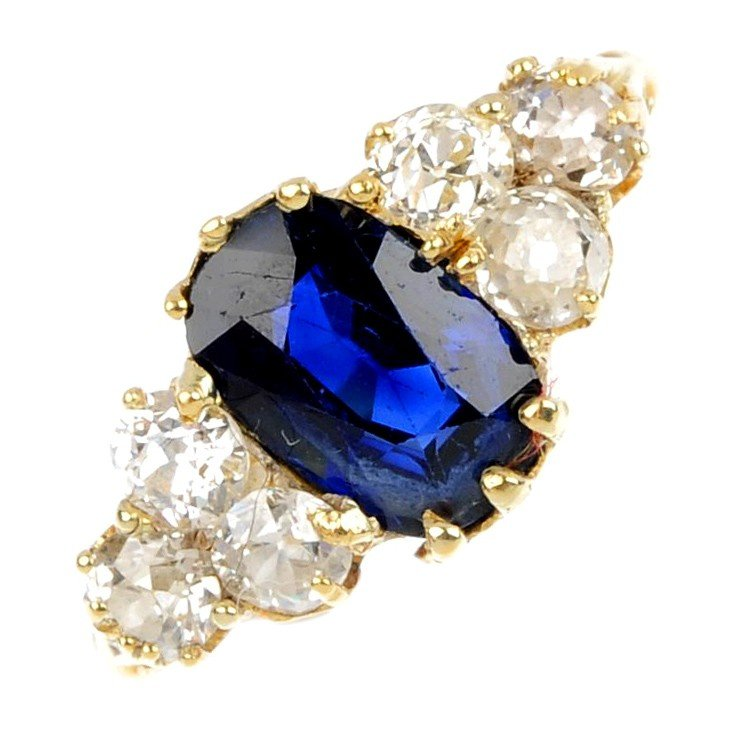 11: A sapphire and diamond ring. The oval-shape sapphir