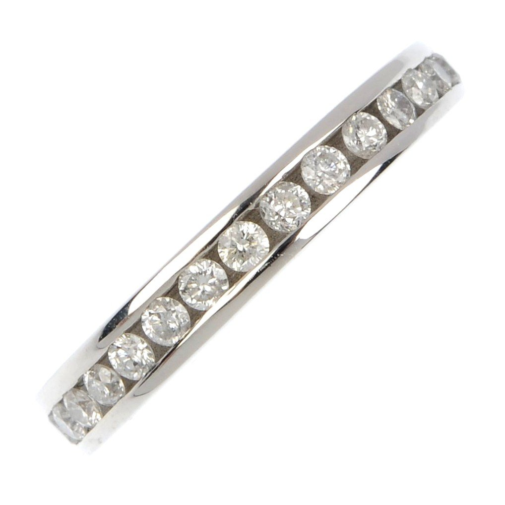 16: An 18ct gold diamond full-circle eternity ring. The