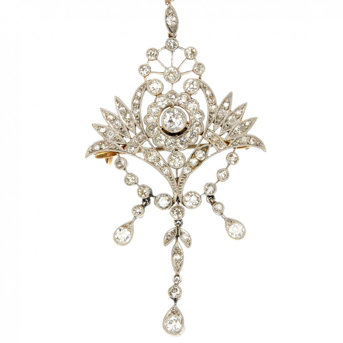 17: An early 20th century diamond pendant. Of openwork