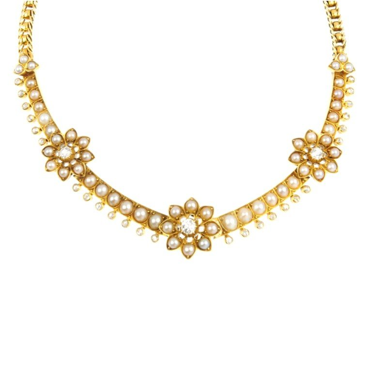 18: A diamond and split pearl floral necklace. Designed