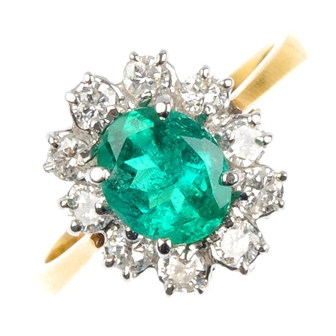 21: An 18ct gold emerald and diamond cluster ring. The
