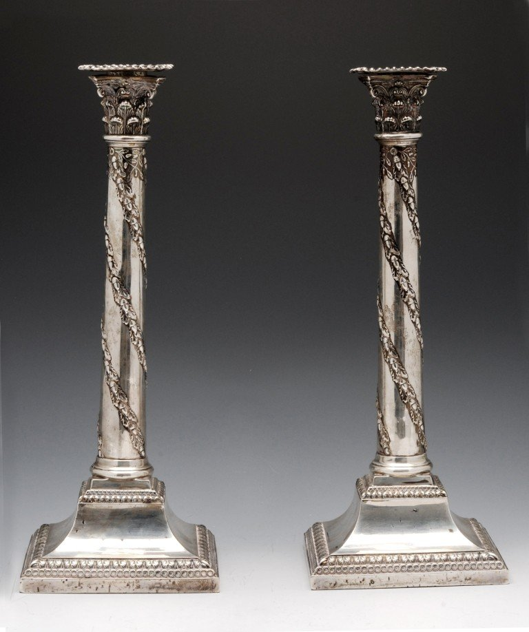 7: A pair of late Victorian silver candlesticks.