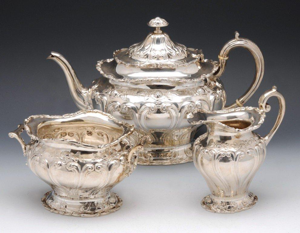 8: Edwardian cased three piece silver tea service.