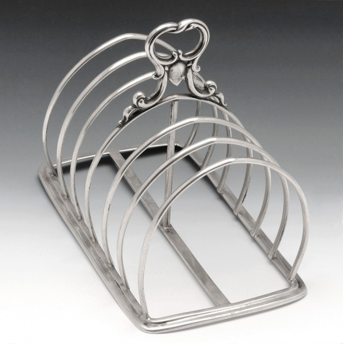 12: A Victorian six divide silver toast rack.