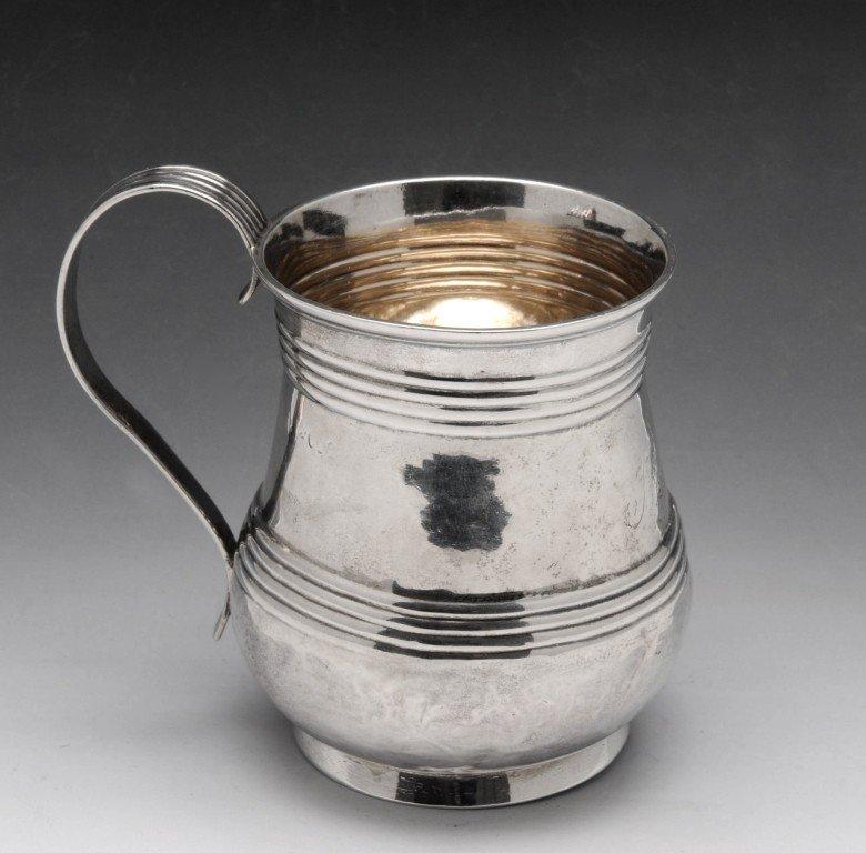 23: A Georgian silver mug.