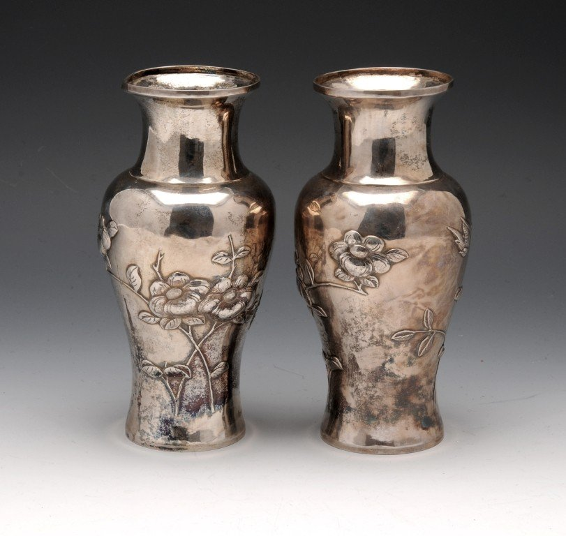 288: A pair of white metal Chinese vases.