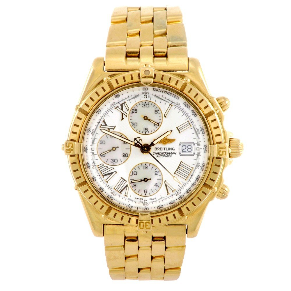 11: BREITLING - an 18ct gold automatic chronograph gent